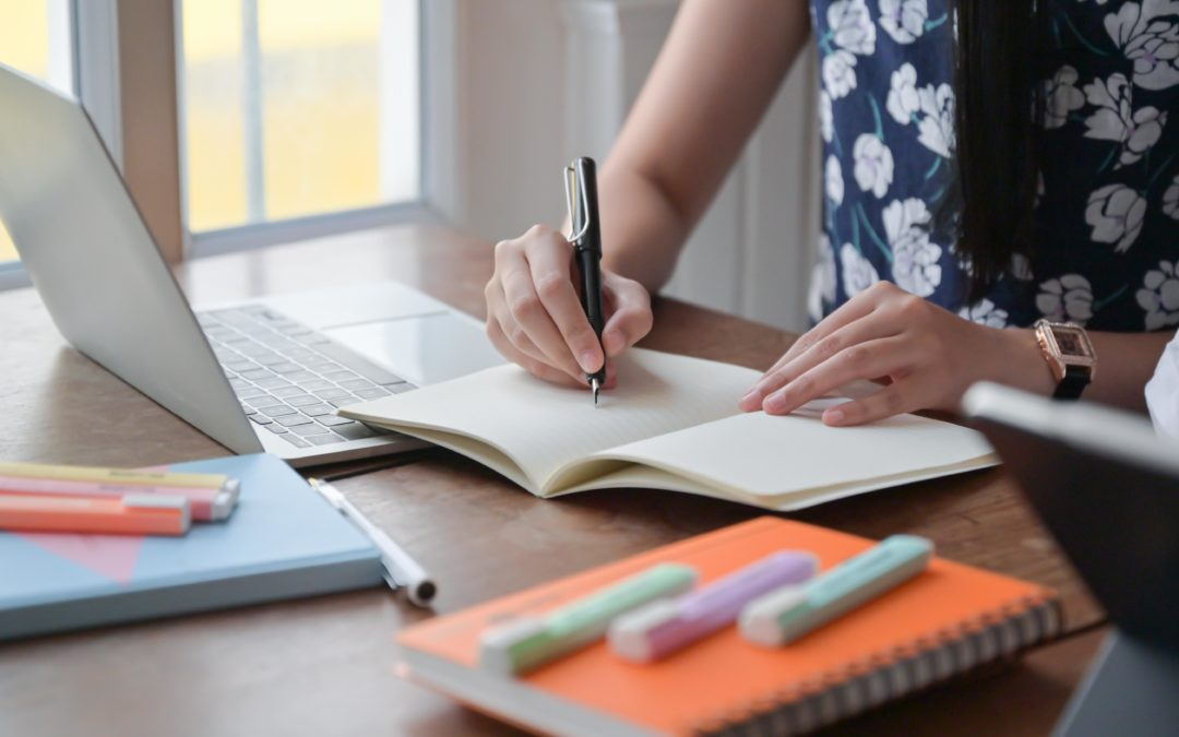 young woman working from home and utilizing tips to stay productive while working from home