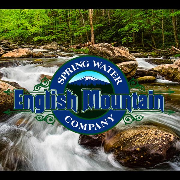 English Mountain Spring Water logo over a natural spring