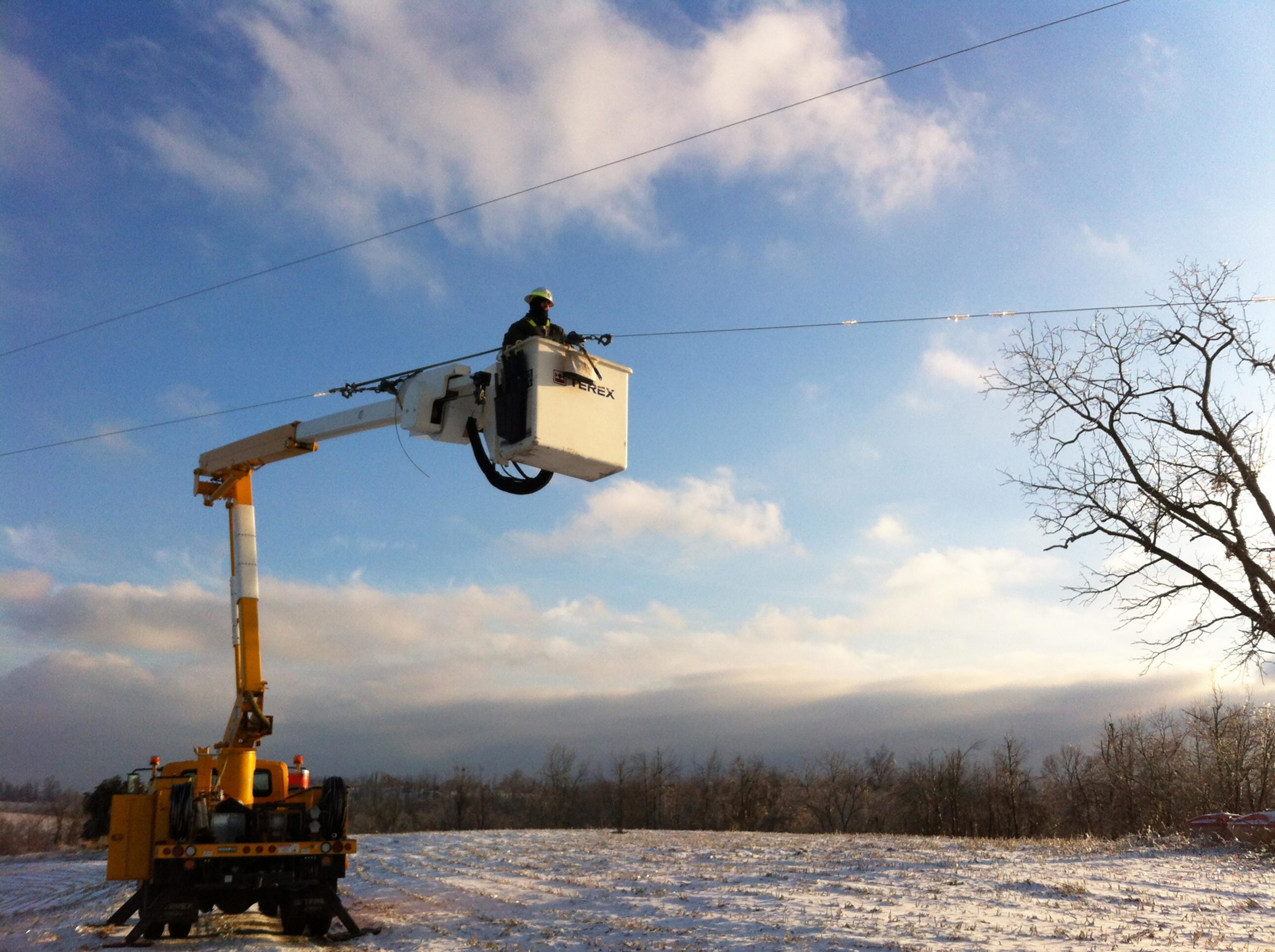 appalachian electric bucket truck in the snow